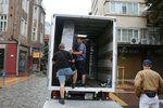разтоварване на товари от камион по поръчка